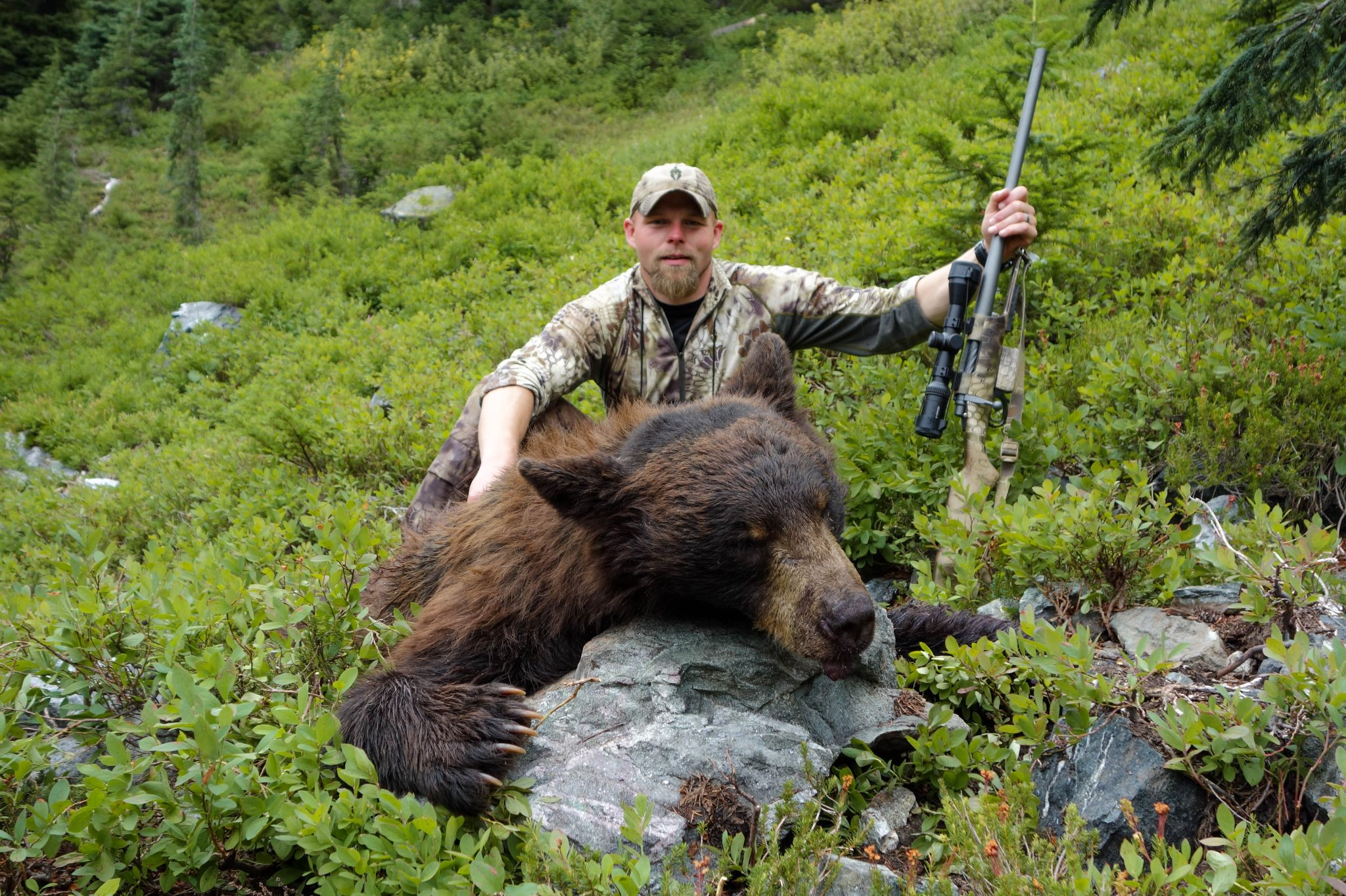 The author posing with a great bear taken on a hair-raising stalk!