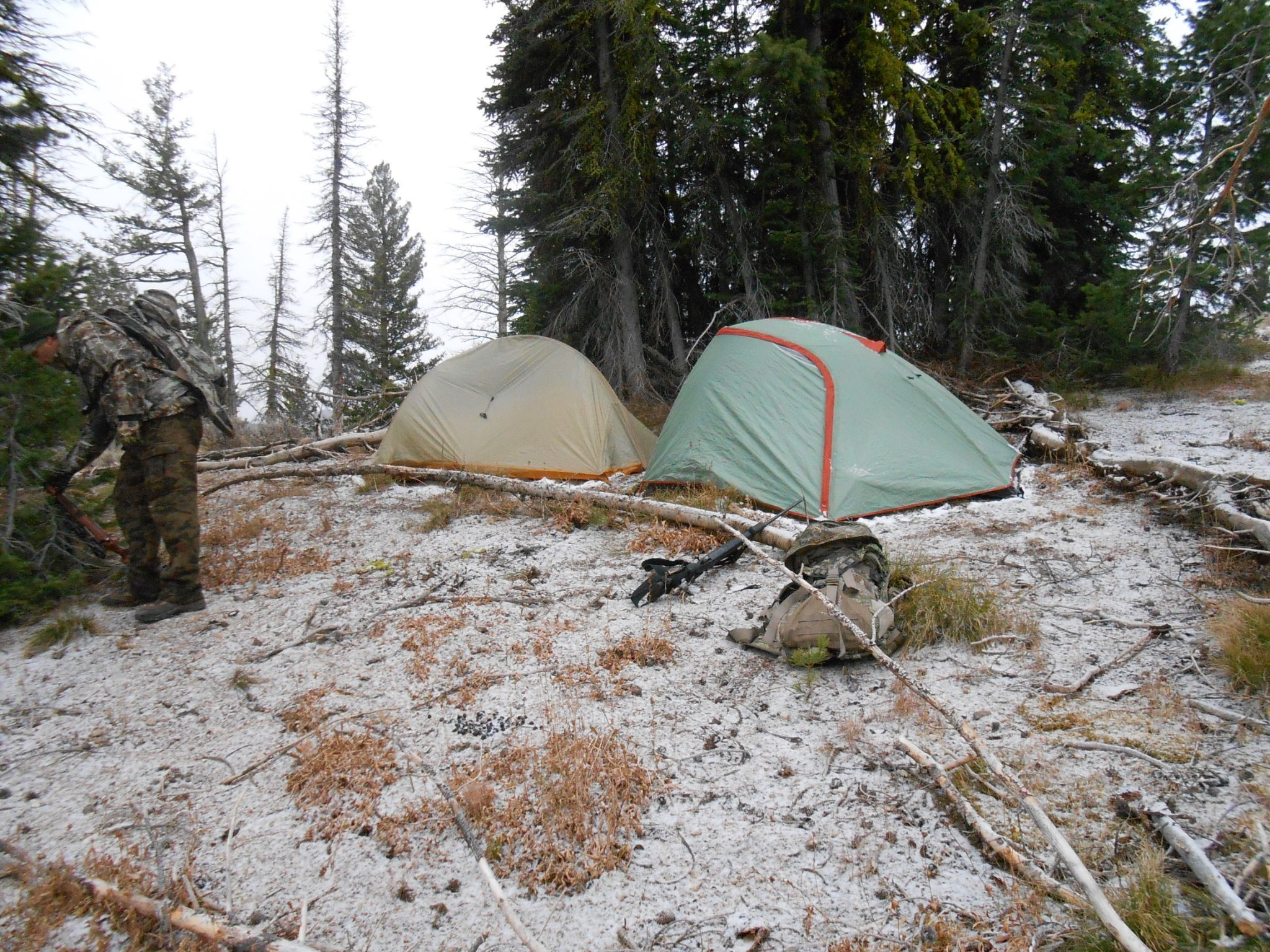 Camp tucked out of view from a high-country basin